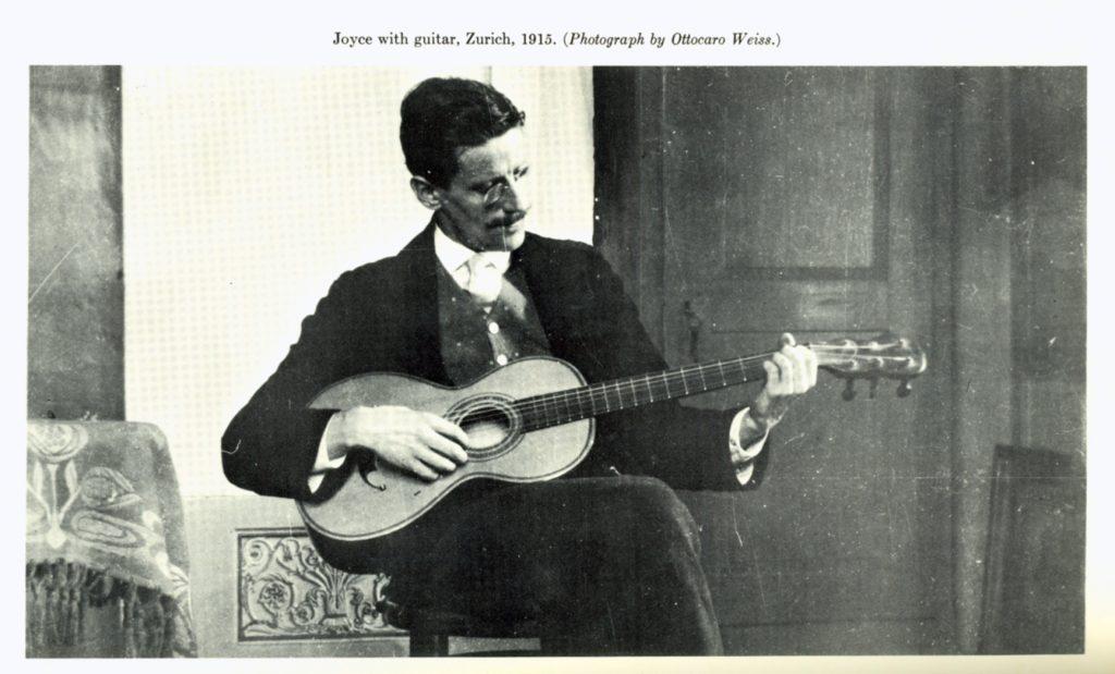 Joyce playing guitar